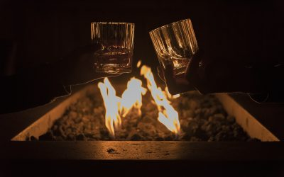 Toasting whiskey by the fire pit at night